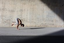 Man performing advanced yoga exercis by  in Sports