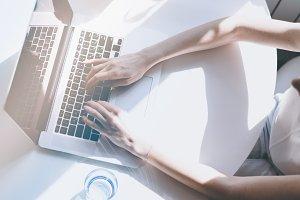 Beautiful business women typing hand