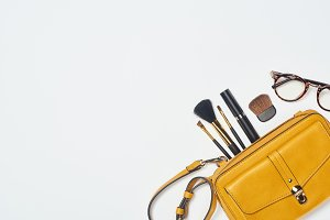 Glasses, mascara, cosmetic brushes a