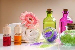 Oils and bath salts on table