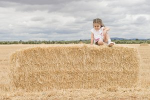 Girl in straw field