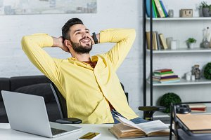 Smiling bearded businessman in yello