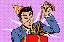Male birthday unpacks the gift
