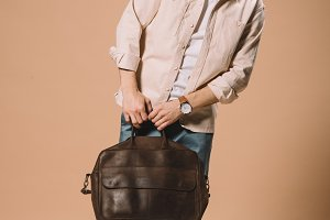 handsome man in glasses holding bag