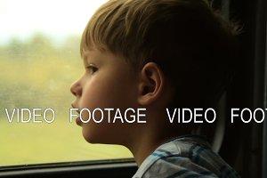 Kid looking through the train window