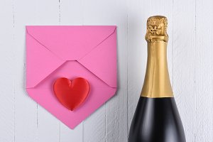 A bottle of champagne with a pink en