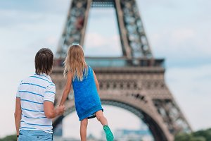 Little cute girl and her father in P