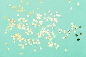 Golden confetti mint background