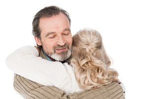 cheerful senior man hugging wife iso