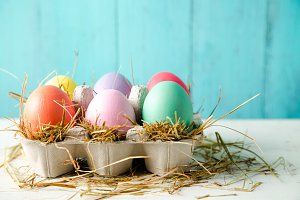 Pastel colored easter eggs in a egg
