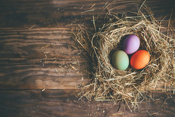 Easter eggs in hay nest on a rustic…