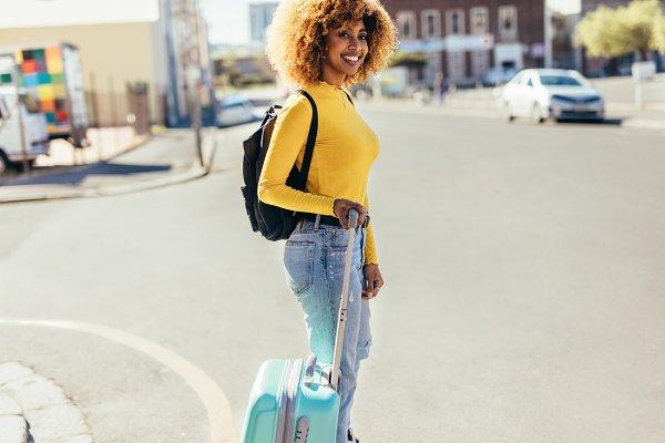 Tourist woman crossing the street