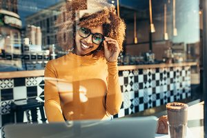 Smiling woman sitting at a cafe