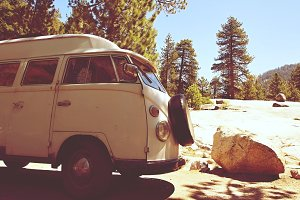 Classic Old VW Bus Parked in Forest
