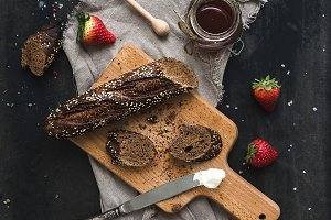 Black baguette toasts with berries