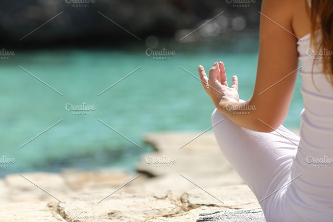 Back view of a woman relaxing with yoga.jpg - Health