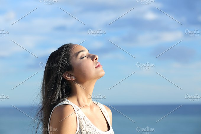 Beautiful arab woman breathing fresh air in the beach.jpg - Health