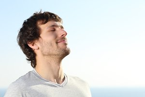 Close up of a man doing breath exercises outdoor.jpg