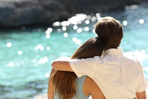Couple hugging and watching the sea on holidays.jpg