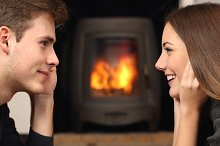 Couple looking each other in front a fireplace.jpg