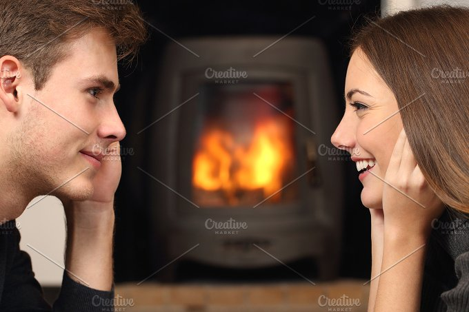 Couple looking each other in front a fireplace.jpg - People