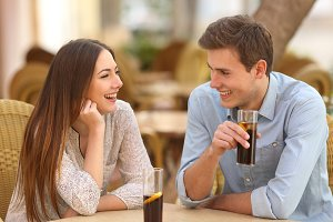 Couple or friends talking in a restaurant.jpg