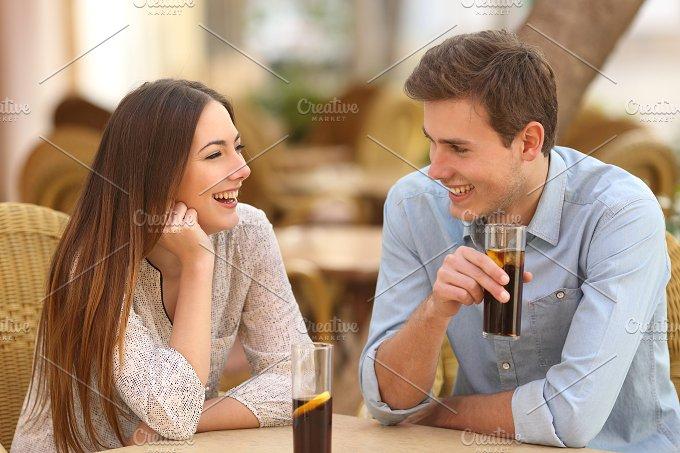 Couple or friends talking in a restaurant.jpg - People