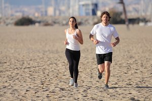 Couple running on the beach.jpg