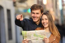 Couple of tourists searching a street in a map.jpg