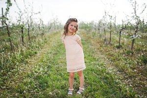 beautiful little girl in blooming