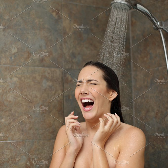 Disgusted woman screaming in the shower under cold water.jpg - People
