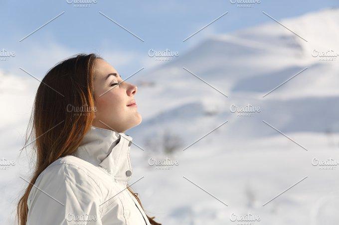 Explorer woman breathing fresh air in winter in a snowy mountain.jpg - Health