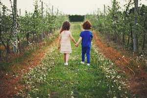 little boy and girl in blooming