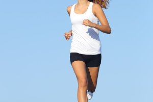 Front view of a beautiful sportswoman running towards camera.jpg