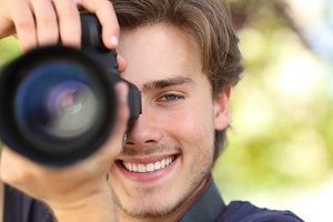 Front view of a photographer photographing with a dslr camera.jpg