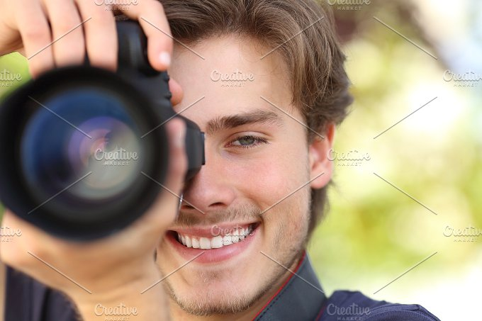 Front view of a photographer photographing with a dslr camera.jpg - Technology