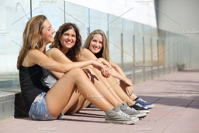 Group of teenager girls talking and laughing happy outdoor.jpg - People