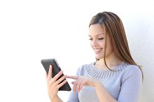 Happy beauty woman texting on a tablet.jpg