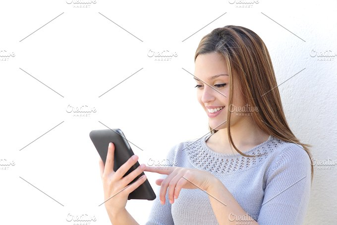 Happy beauty woman texting on a tablet.jpg - Technology