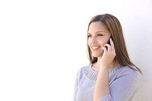 Happy woman calling on the smart phone.jpg