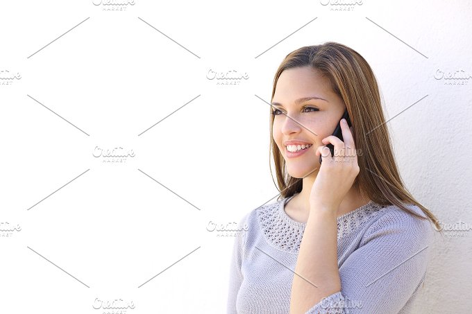 Happy woman calling on the smart phone.jpg - Technology
