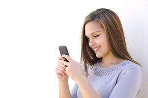 Happy woman texting on a smartphone looking at phone.jpg