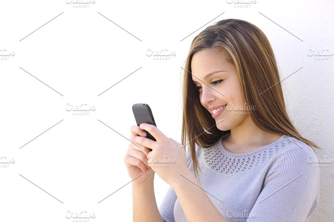 Happy woman texting on a smartphone looking at phone.jpg - Technology