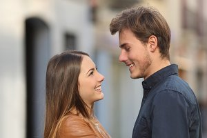 Profile of a couple looking each other in the street.jpg