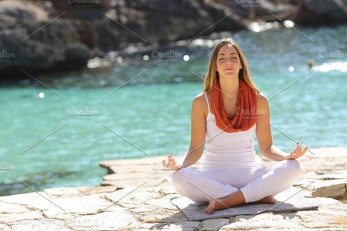 Relaxed girl doing yoga exercises on holidays.jpg - Health