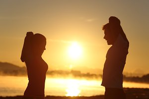 Silhouette of a fitness couple stretching at sunrise.jpg
