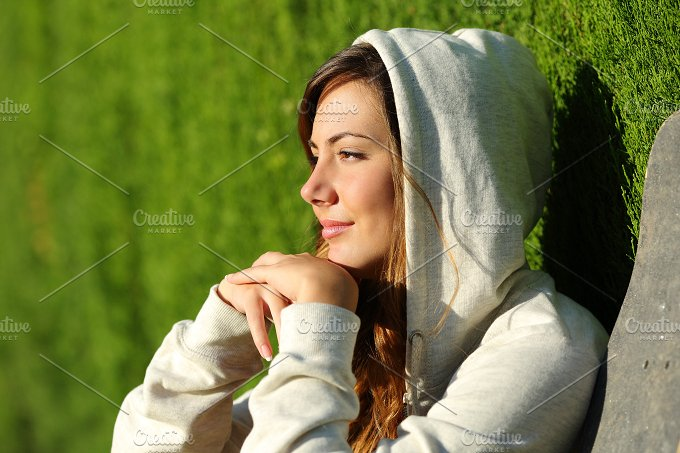 Side view portrait of a pensive teenager skater girl thinking.jpg - People