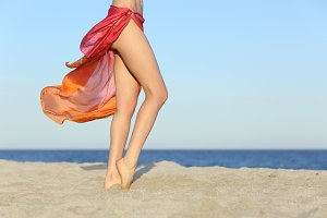 Standing woman legs posing on the beach wearing a pareo.jpg
