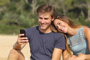 Teenager couple sharing social media on the smart phone.jpg