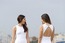 Two women with the same dress looking each other with hate.jpg